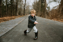 Portrait Of Boy Playing With S...