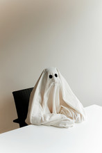Man In Ghost Costume Sitting B...
