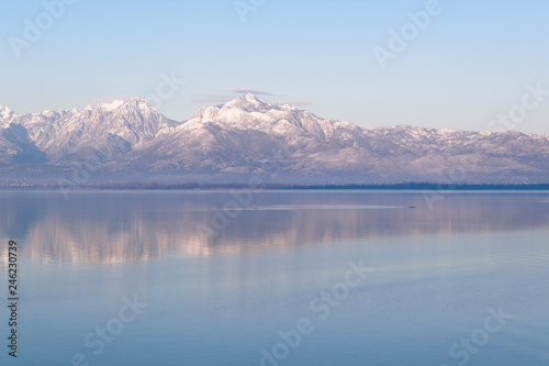 Poster Lac / Etang Beautiful scenic landscape of Shkodra lake, mountains reflection