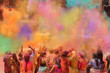 Leinwanddruck Bild People celebrating the Holi festival of colors in India or Nepal