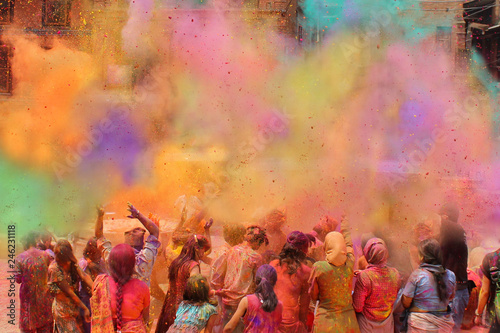 Vászonkép People celebrating Holi festival of colors, India