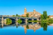 Cathedral At Salamanca Reflected Viewed Behind Bridge Of Enrique Esteven On River Tormes, Spain