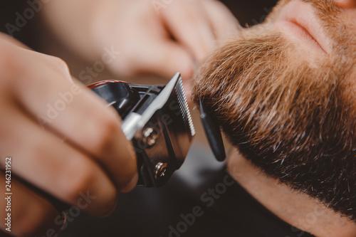 Macro Man hipster having barber shave barbershop hair machine
