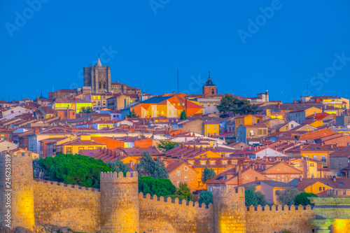 Sunset view of cityscape of Avila dominated by Cathedral of Saint Salvador, Spain
