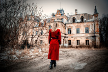 Beautiful Woman In Red Coat St...