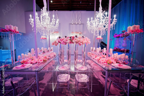 Fotografie, Tablou High end wedding tablescape with pillar candles and pink orchids and chandelier