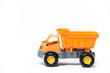 canvas print picture -  Plastic toy yellow truck on a white background. Close-up.