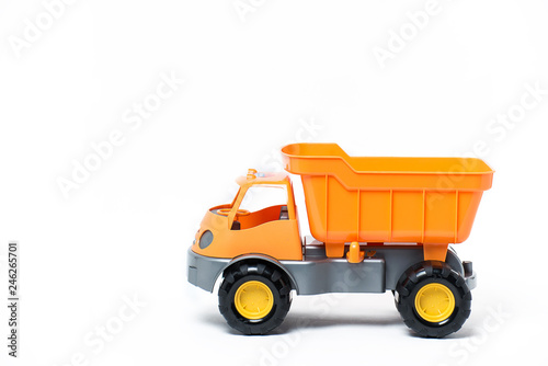 Obraz na płótnie Plastic toy yellow truck on a white background. Close-up.