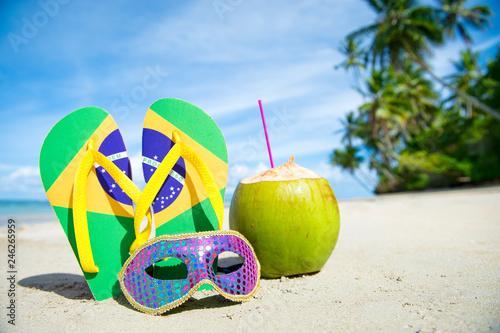 Fotografie, Obraz  Brazil flag flip-flops and brightly sequined carnival mask resting together in t