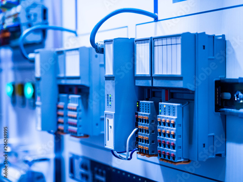 Electrical Circuits The Electric Wire Behind The Control Board With Lighting Effect Industrial Electrical Concept Wiring Plc Control Panel With Wires Industrial Factory Buy This Stock Photo And Explore Similar Images At
