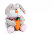Soft toy hare on a white background
