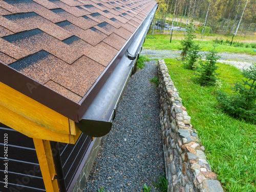 Fototapeta Holder gutter drainage system on the roof