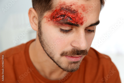 Young man with head injury in clinic. First aid