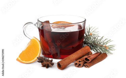 Deurstickers Cocktail Composition with glass cup of mulled wine, cinnamon, orange and fir branch on white background