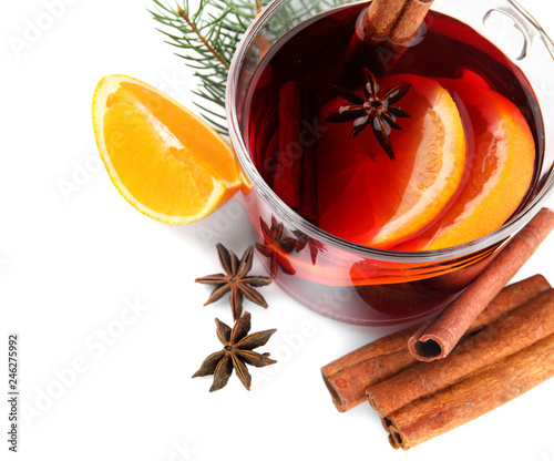 Fotobehang Cocktail Composition with glass cup of mulled wine, cinnamon, orange and fir branch on white background