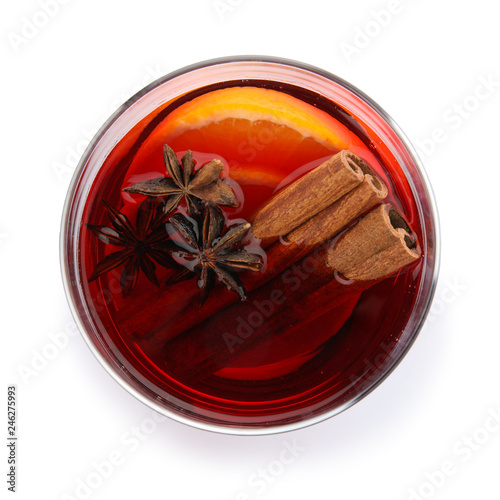 Glass of mulled wine with spices isolated on white, top view