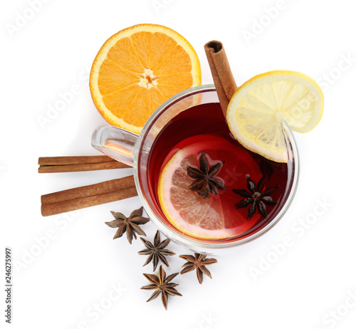 Fotobehang Cocktail Glass cup of mulled wine, orange and cinnamon sticks on white background, top view