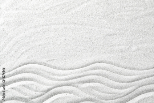 Stampa su Tela  Zen garden pattern on sand as background, top view with space for text
