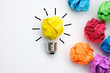 Great idea concept with crumpled colorful paper and light bulb on white background