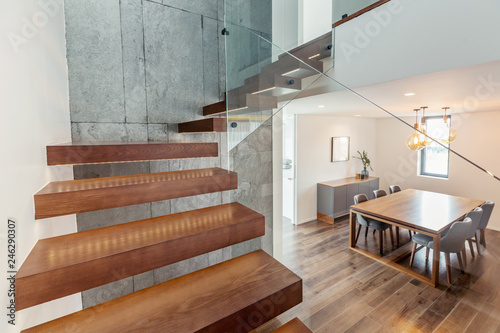 Obraz Living room modern interior design with stairs, grey colours, white walls - fototapety do salonu