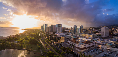 Sun set over skyline of Honolulu