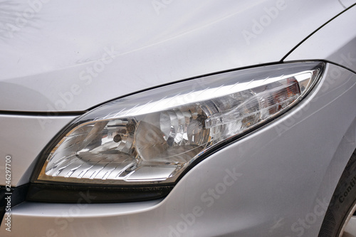 Fototapeta shiny headlights on a white silver car obraz na płótnie