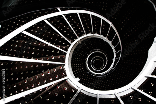 Valokuvatapetti Spiral staircase with white railings, abstract fractal, top view.