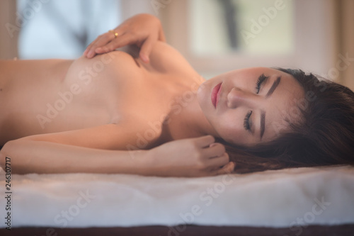 Photo  young woman asian girl  posing emotion sexy  sleepy naked on white bed in the be