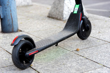 Electric Scooter In The Sidewalk