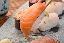 Chopsticks Picking Up Salmon Sushi
