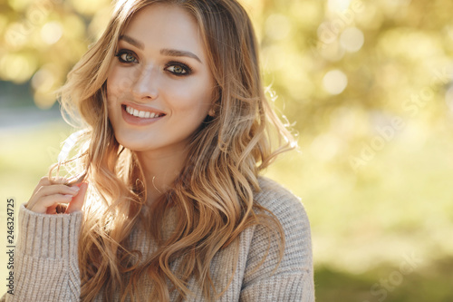 Fototapeta  Fashion autumn portrait woman with yellow maple leaves on Nature Background