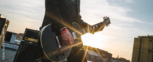 Guitarist playing outdoors Wallpaper Mural