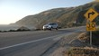 View of cars on Cabrillo Highway 1 at Big Sur, near Carmel, California, United States of America, North America