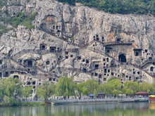 Luoyang Longmen Grottoes. Broken Buddha And The Stone Caves And Sculptures In The Longmen Grottoes In Luoyang, China. Taken In 14th October 2018