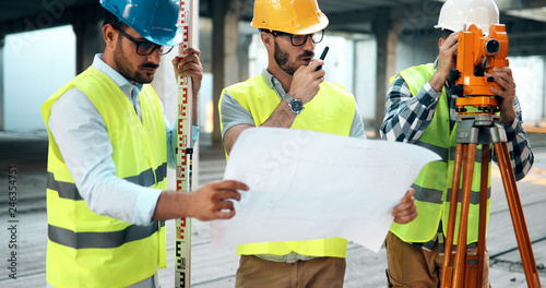 Construction engineers discussion with architects at construction site