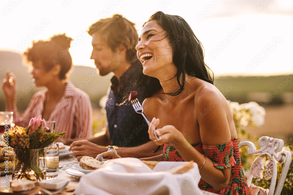 Fototapety, obrazy: Woman enjoying with friends at outdoor dinner party