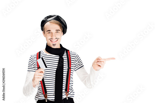 Obraz cheerful french man holding credit card and pointing with finger isolated on shite - fototapety do salonu
