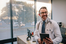 Doctor With Digital Tablet In His Office