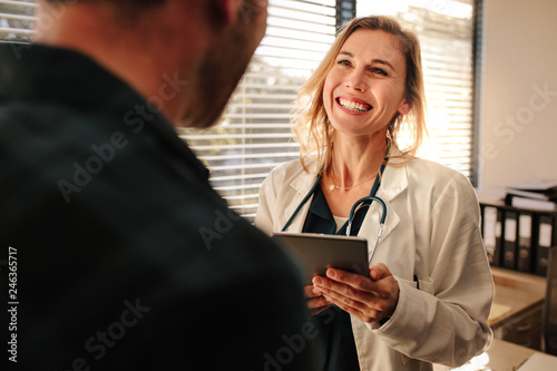 Fototapeta Friendly doctor interacting with her patient obraz