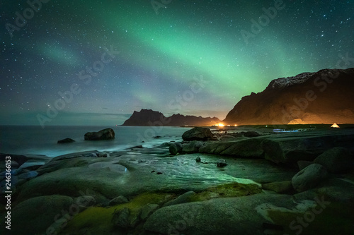 Lofoten aurora above moutains and sea