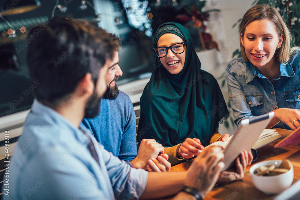 Fototapety, obrazy: Group of students of diverse ethnic learning at home. Learning and preparing for university exam.