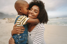 Boy Enjoying At Day Out With His Mother On The Beach