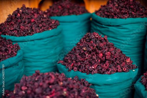 Dry herb hibiscus in baskets. Arabic herbs on traditional bazaar. Natural organic food.