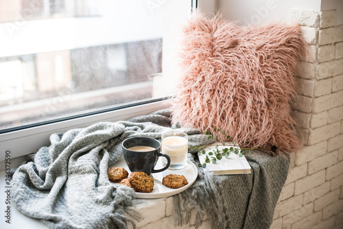 Scandinavian style breakfast, cup of coffee and cookies on cozy windowsill with Canvas Print