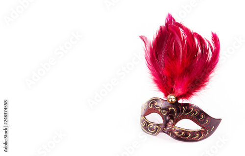 Carnival mask with red feathers. Fancy Dress Mask. Masquerade mask on white background. Copy space
