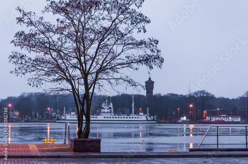 Fotobehang Poort HARBOR WHARF - Landscape of Swinoujscie at the shores of the port channel