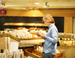 Teenager choosing bread from a supermarket