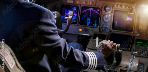 Fotografie, Obraz  Over the Shoulder of an African Pilot in a Jumbo Cockpit