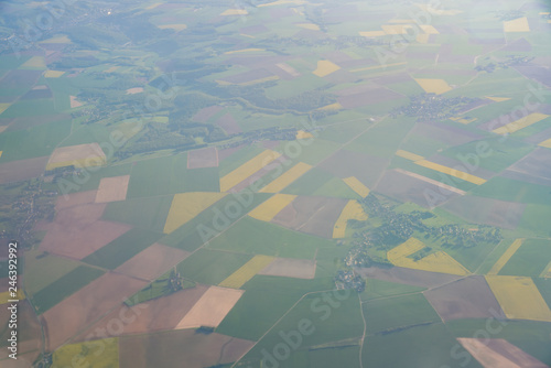 Wall Murals Air photo Aerial view of France rural landscape with some Canola flower blossom