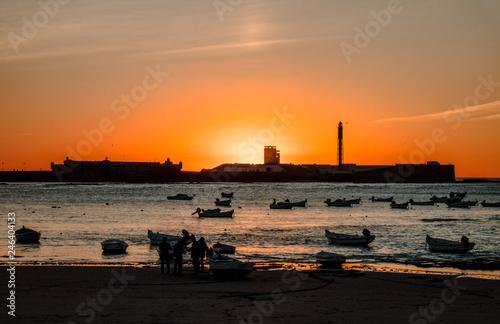 Sunset over the Castle of San Sebastian on the beach of La Caleta in the bay of the capital of Cádiz, Andalusia. Spain.